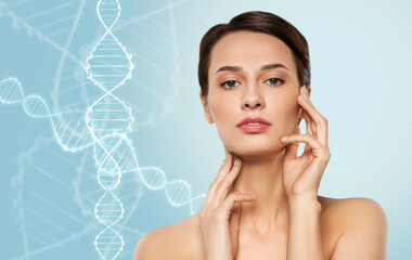 beauty, technology and genetics concept - beautiful young woman touching her face and neck skin...
