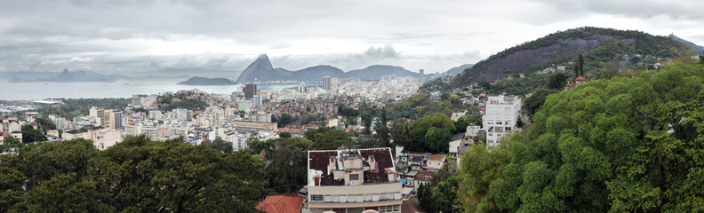 Rio de Janeiro, Brazil: panoramic view south from the Ruins Park in Santa Teresa, with Corcovado mountain to the far right and sugarloaf mountain center left. Fototapete
