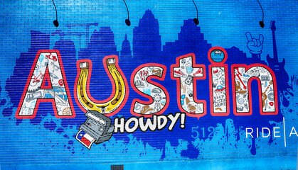"""Austin, Texas, March 14, 2019. """"Austin Howdy"""" wall painting at 6th street  with Texas symbolic"""
