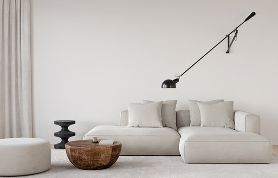 Stylish living room in beige tones with a sofa, a sconce, a wooden table, a marble side table and pouf
