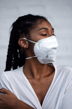 Young black woman in face mask