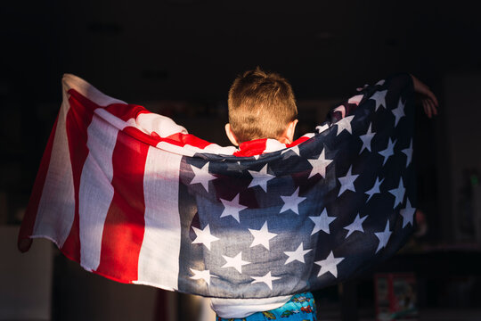Child on his back with the American flag. 4th of July Celebration