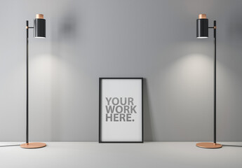 Vertical Black Frame Mockup Standing on Gray Floor with Two Lamps