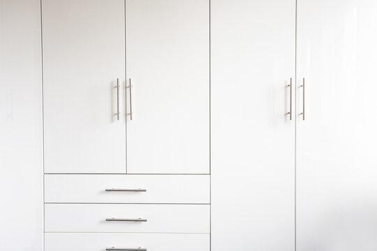 White luxury cupboard doors modern design, closet doors retro background texture abstract new interior
