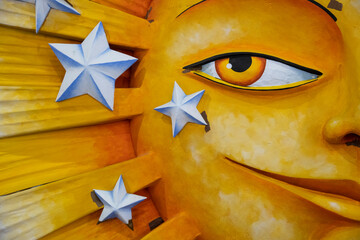 Detail of a giant sunshine made of styrofoam that will appear on a Mardis Gras float