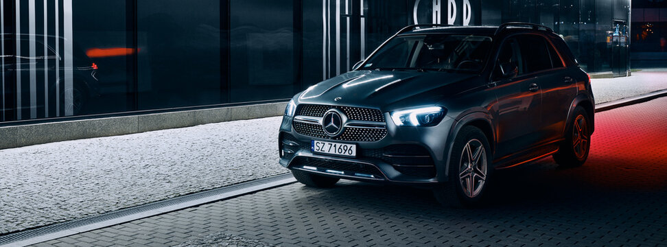Katowice/Poland - 01.12.2020: Mercedes GLE parked next to a modern night-lit building. Mercedes GLE is luxury SUV with V6 engine.