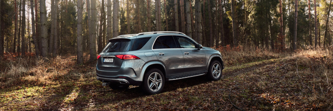 Orzesze/Poland - 01.12.2020: Luxury Mercedes GLE with 4x4 drive on off-road in the forest. V6 engine, 367 hp.