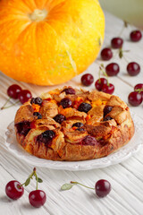 Homemade Bread and butter pudding with pumpkin and cherry berries.  Casserole. Traditional delicious sweet Breakfast for gourmets. Dessert. Selective focus