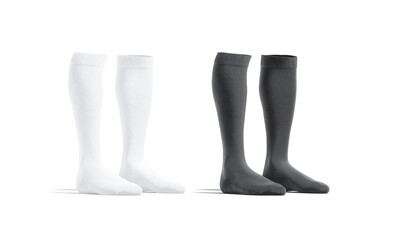 Blank black and white soccer socks mockup pair, half-turned view