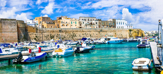 Summer vacation in Puglia, Otranto old town, view with castle and marine. South of Italy