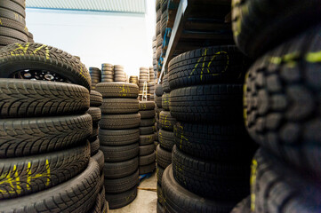 Close-up of rubber tire stacks at illuminated store