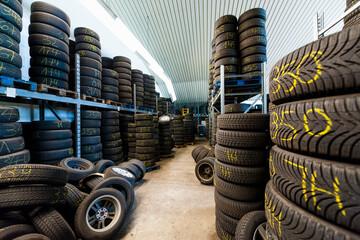 Interior of rubber tires at illuminated store