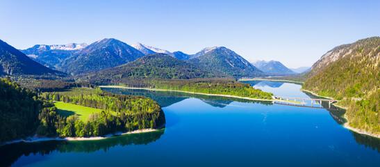 Germany, Bavaria, Lenggries,  Sylvenstein Reservoir in spring with Faller-Klamm-Brucke in background
