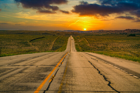 Long road into the sunset near Cody Wyoming.