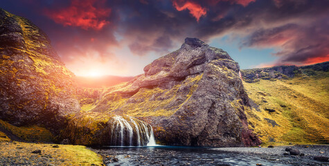 Fotorolgordijn Cappuccino Wondeful nature landscape of Iceland. Fantastic picturesque scenery with waterfal and colorful sky during sunset, Iceland Is one famous natural landmark and travel destination place. Wild area image.
