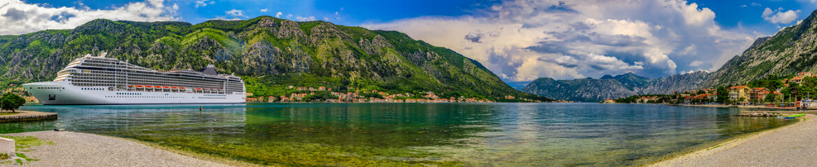 Panorama of Kotor Bay with a cruise ship and mountains reflecting in the water, Balkans on Adriatic Sea in Kotor, Montenegro