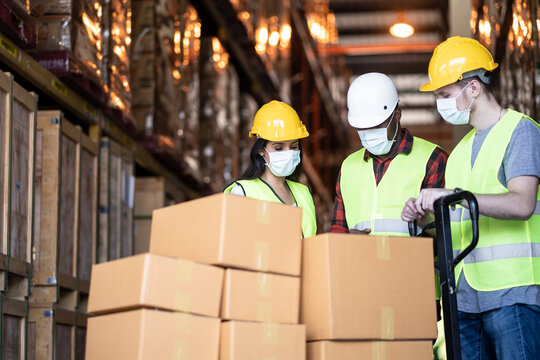 Group of diversity Workers wearing protective mask working in factory