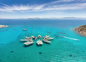 Aerial View of Sailing boats in star formation in Greece (Polyaigos, Cyclades) the largest uninhabited island of the Aegean Sea and one of the best and most beautiful sailing destinations
