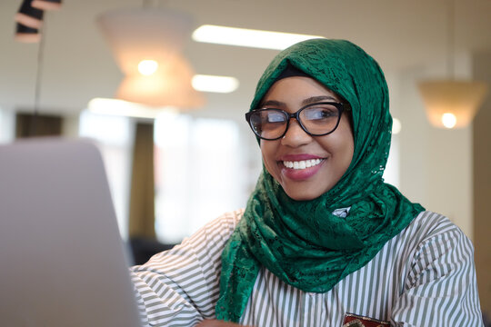 african muslim business woman working on laptop computer