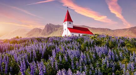 Amazing Icelandic Landscape. Scenic image of most popular tourist destination of Iceland. Great view of Vikurkirkja christian church in evening light. Vik i Myrdal village, Iceland, Europe.