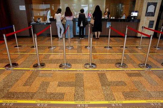 """People buy tickets in a line to watch the musical """"Mozart"""" to avoid the spread of the coronavirus (COVID-19) at the Sejong Center for the Performing Arts in Seoul"""