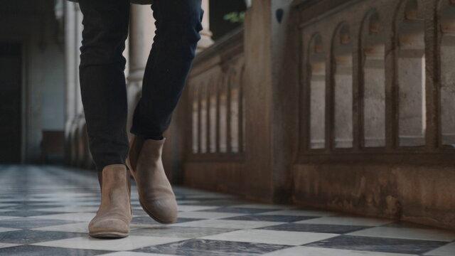 Student feet walking in university building. Businessman legs going for work
