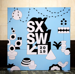 AUSTIN, TEXAS - MARCH 11, 2019: SXSW South by Southwest Annual music, film, and interactive conference and festival. Austin Convention Center, SXSW sign and symbols poster.