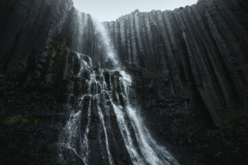 Wall Murals Gray Studlafoss waterfall with basalt columns in East Iceland