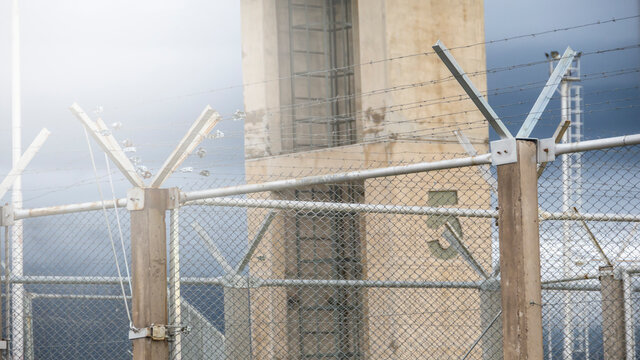Federal Prison With Barbed Wire Fence And Guard Tower