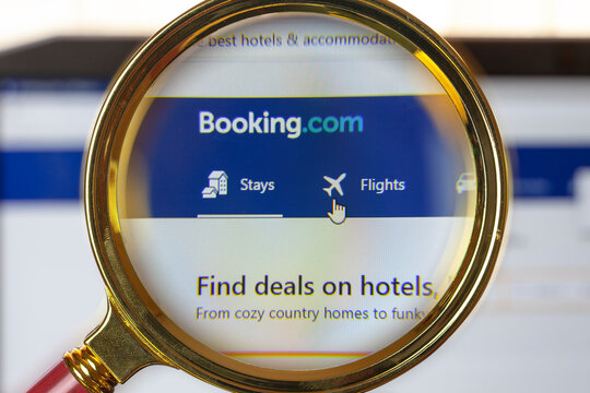"""a search engine for booking hotels around the world """"booking.com"""", close-up under a magnifying loupe"""