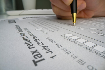 Close-up view of completing Australian tax form