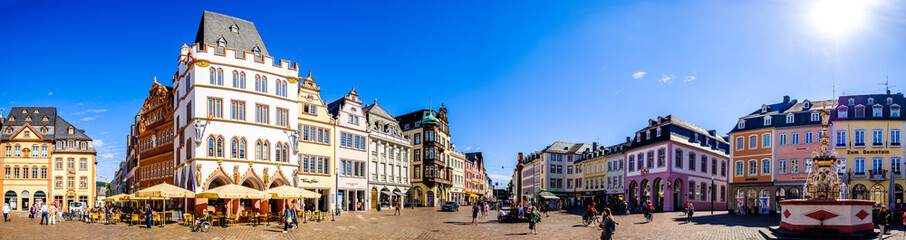 Trier, Germany - July 7: historic buildings and tourists at the famous old town of Trier in Germany on July 7, 2020