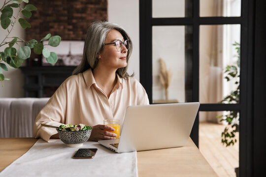 Concentrated business woman using laptop computer