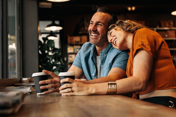 Smiling couple at coffee shop