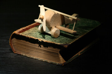 Wooden Airplane On Book