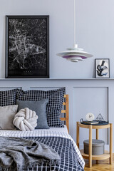 Stylish scandinavian bedroom interior with design coffee table,  mock up poster frames, book,...