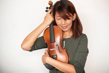Violin was hugging by lady,model posing with acoustic instrument