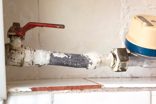 old lead pipe to replace by professional plumber due to health hazard