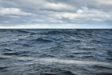 North sea under the dark clouds after the thunderstorm. A view from the sailing boat. Dramatic stormy sky. Epic cloudscape. Norway. Cyclone in winter. Ecology, global warming concepts