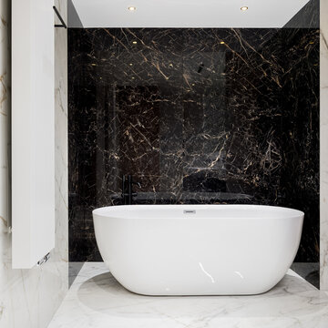 Big oval bathtub in marble tile bathroom