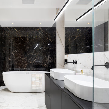 Elegant bathroom with black marble wall