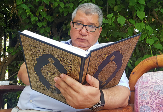 Mahmoud Ali 55 years old, a man whose pilgrimage trip was canceled due to the outbreak of the coronavirus disease (COVID-19), reads the holy Koran at his home, in Cairo
