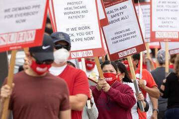Long-term care hospital workers protest over patient and staff safety outside the facility in Westminster, California