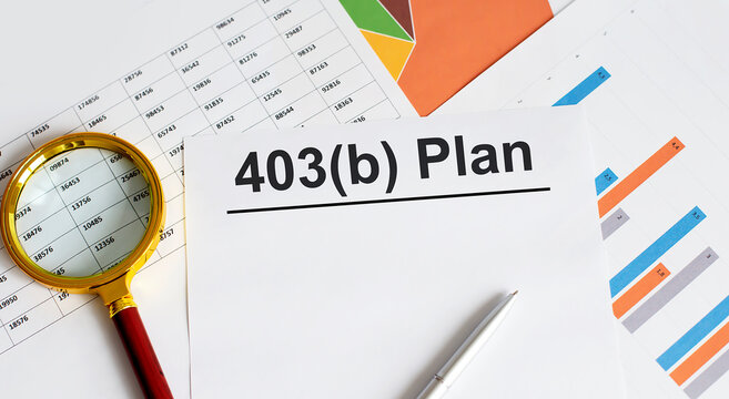 Document with sign 403b plan with chart, pen and magnifier .Retirement concept.