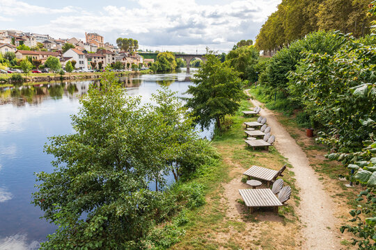Chaise lounges on a pathway along the Vienne River in Limoges.