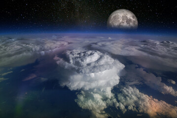 Landscape from space, with huge hurricane birth clouds and starry sky and moonrise. Elements of this image furnished by NASA.
