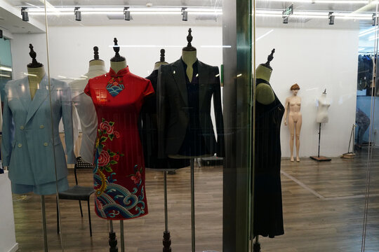 Mannequins dressed in women's wear are seen inside a bespoke tailoring shop which is out of business, following the coronavirus disease (COVID-19) outbreak, in Beijing