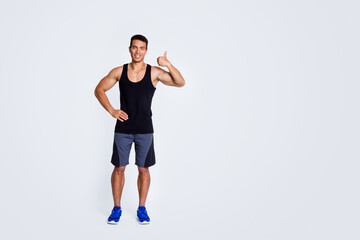 Full length body size view of his he nice attractive strong tall sportive cheerful muscular guy showing thumbup advert ad advertisement isolated over light gray pastel color background