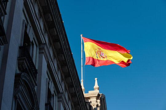spain flag against blue sky