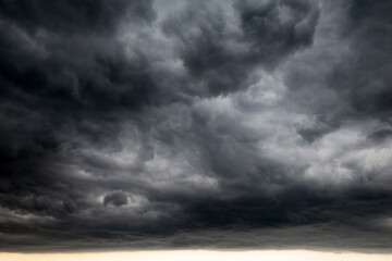 Sky covered with dark storm clouds. Dramatic background for weather before rain